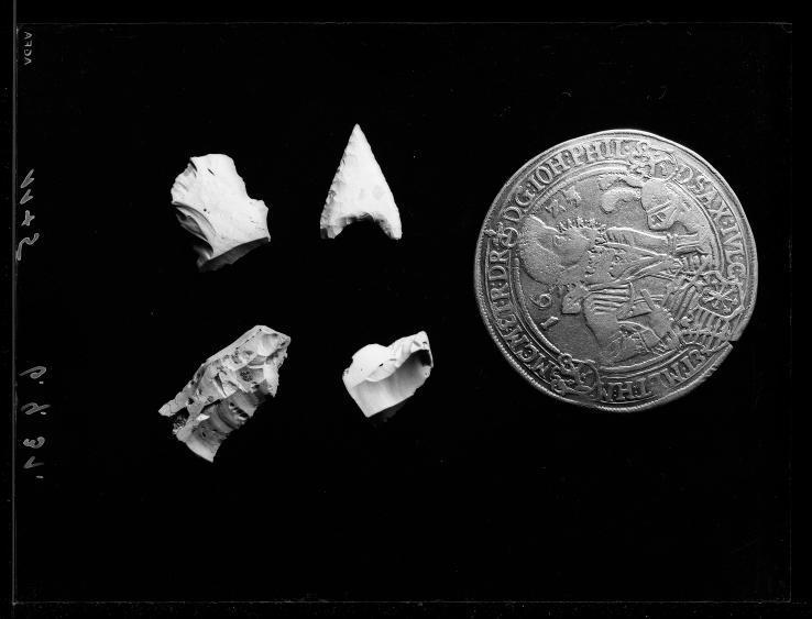 Fotographie Münze und archäologische Funde